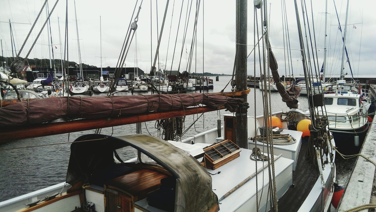 Taken with my HTC One M7 - 2015 Denmark Nautical Vessel Sailboat Mast Tall Ship Sailing Ship Harbor Sky Water Sea No People Outdoors Close-up Rigging Day Denmark Langeland Fishing Port Maritime Harbor Cloudy Cloud - Sky Moored Yacht Yachting