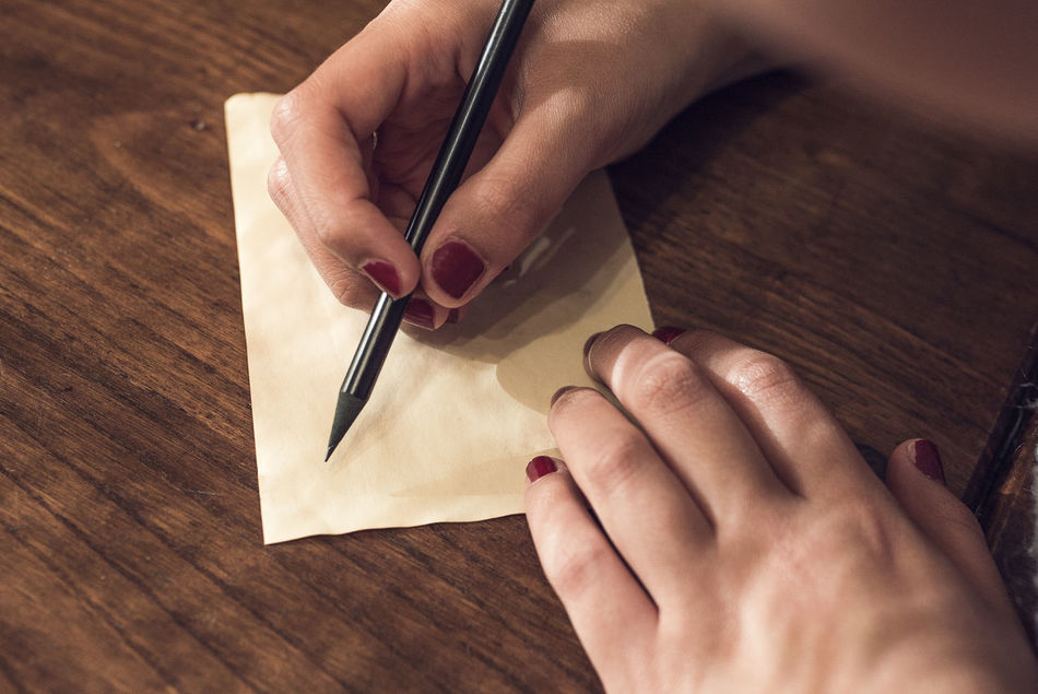 Adult Adults Only Blank Close-up Day Dear Handwriting  Human Body Part Human Hand Indoors  Letter Message Nails One Person One Woman Only Only Women Pen Pencil People Table Wood - Material