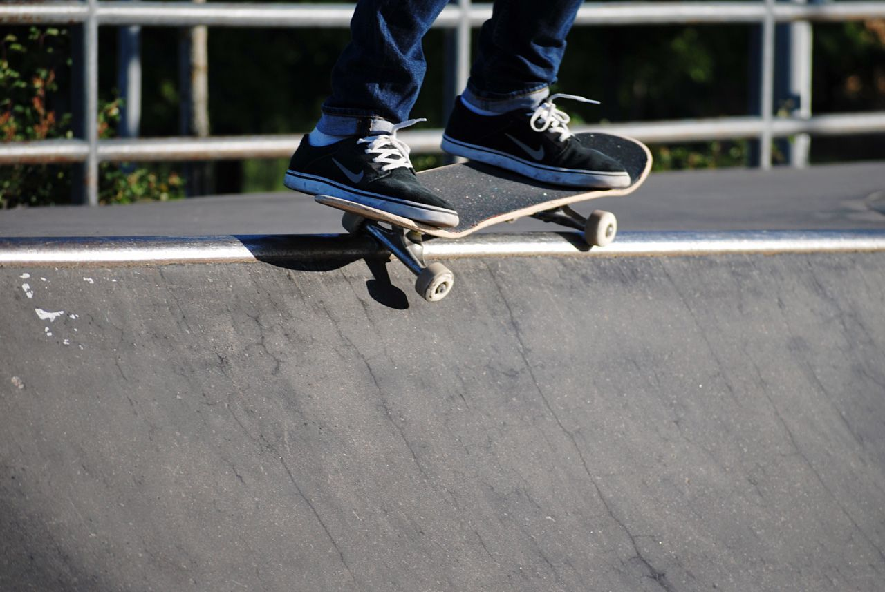 low section, human leg, shoe, one person, real people, lifestyles, leisure activity, outdoors, day, skateboard, human body part, motion, jumping, skill, men, sport, skateboard park, people