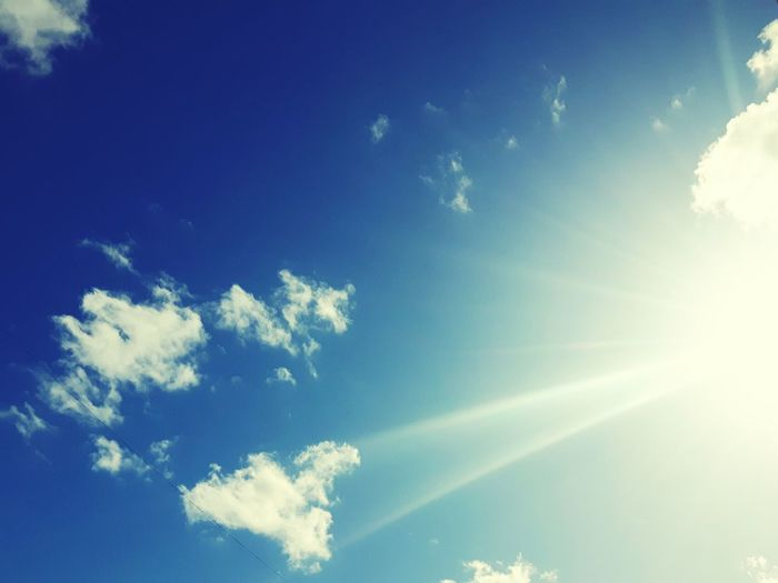 sun radiant in blue and cloudy sky Sunbeam Sky Blue Outdoors Cloud - Sky No People Nature Day
