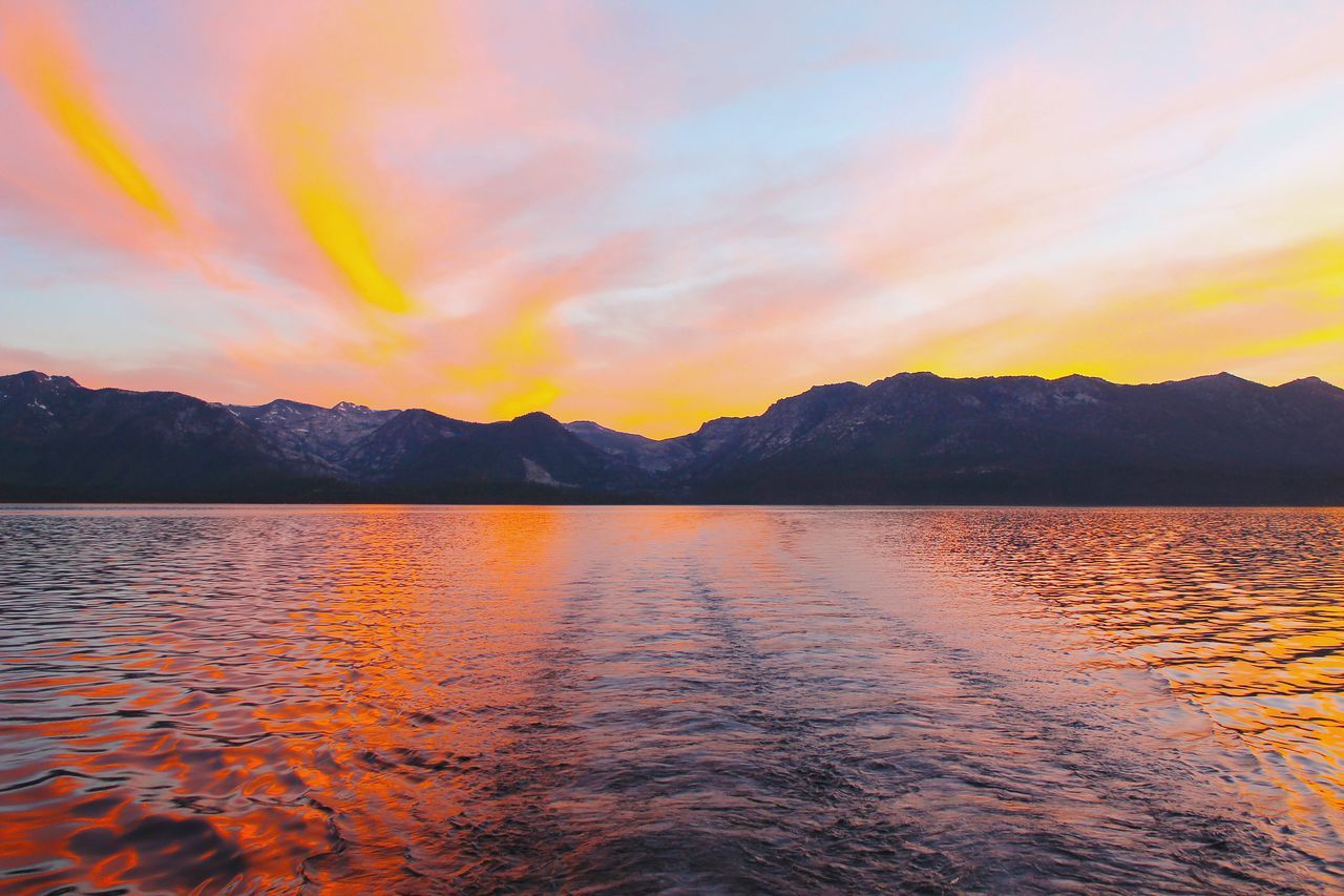 Lake Tahoe sunset. Lake Sunset Water Lake Tahoe California Sunset Boat Sky Color Mountains