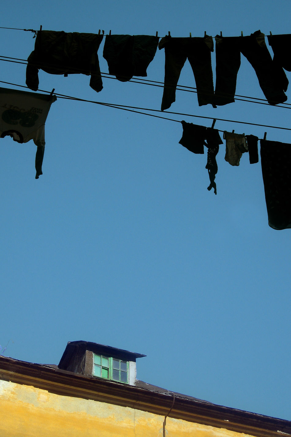 Hanging laundry shandes Architecture Blue Building Clear Sky Day EyeEm Best Shots EyeEm Gallery EyeEmBestPics Garrett Hanging Horizon Over Water Laundry Laundry Day Laundry Hanging Laundry Line Low Angle View No People Outdoors Roof Rooftop Rooftops Sky The Week On EyeEem