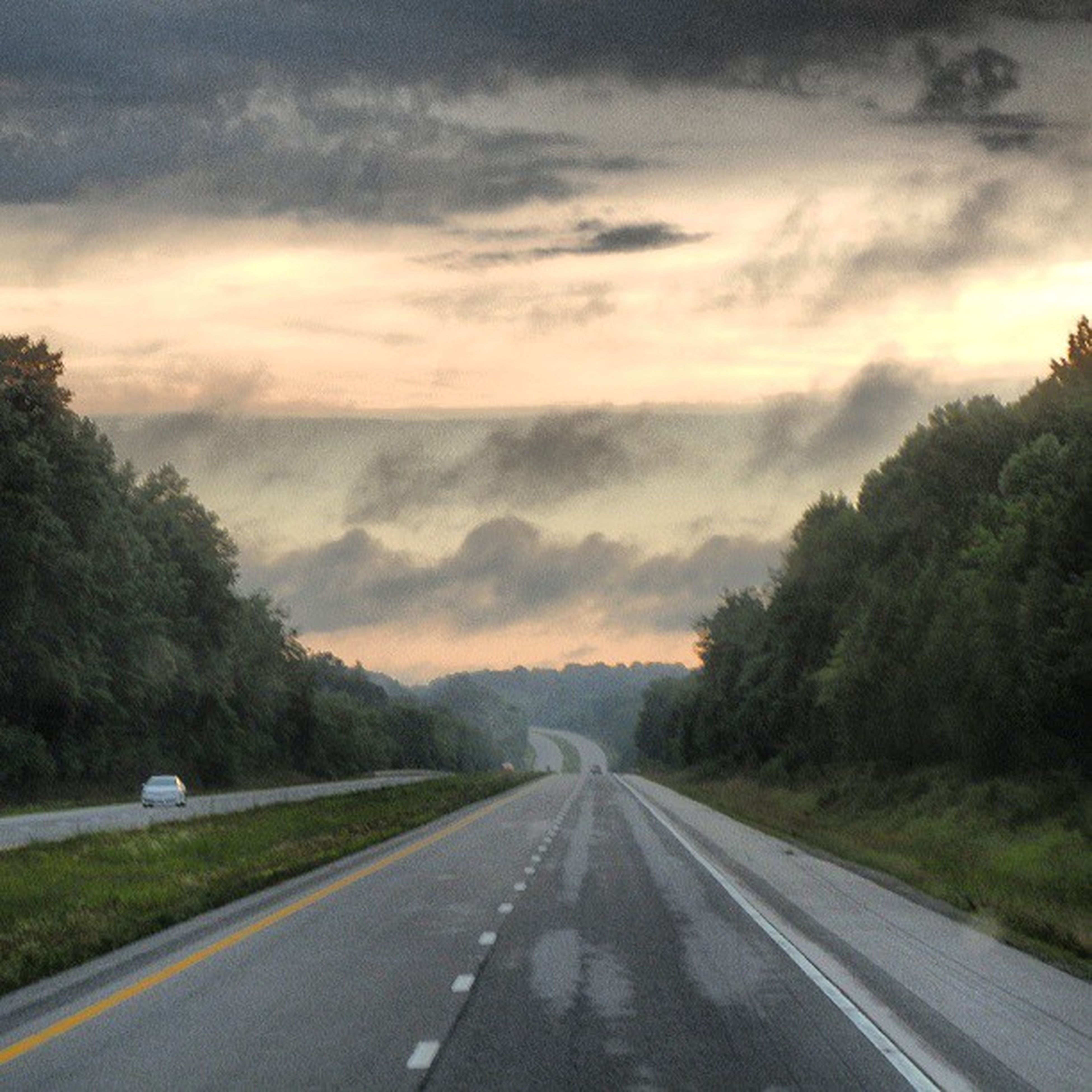 the way forward, road, sky, transportation, cloud - sky, tree, cloudy, diminishing perspective, vanishing point, country road, road marking, cloud, sunset, nature, weather, tranquility, beauty in nature, tranquil scene, scenics, empty road