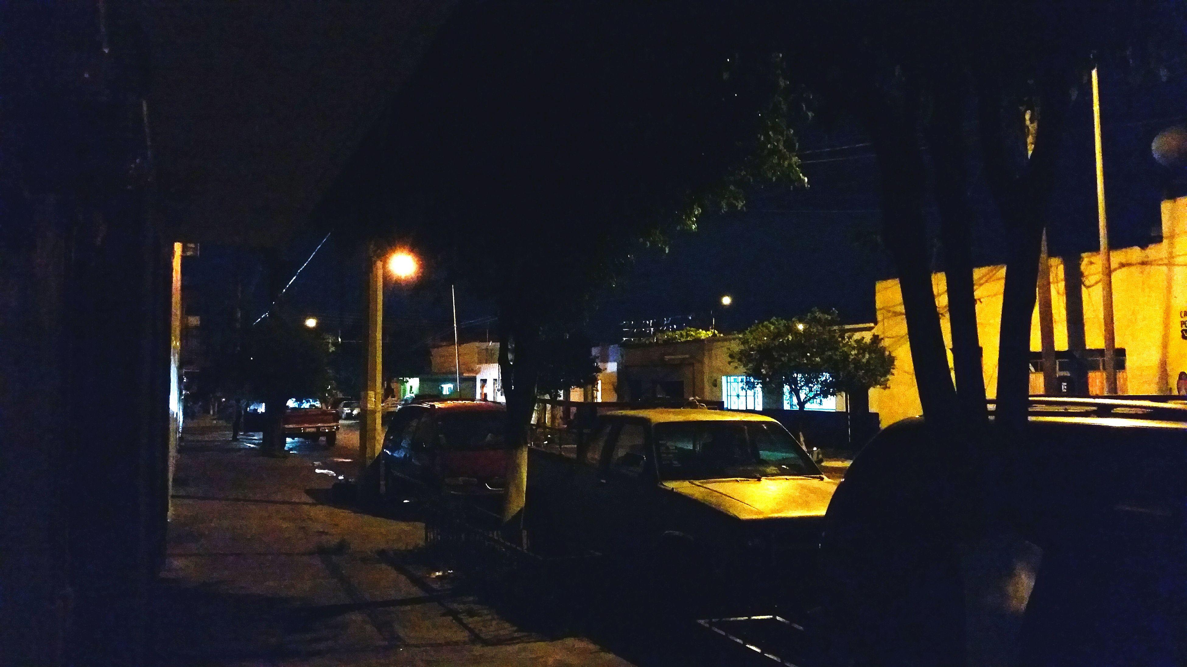 night, illuminated, street light, building exterior, built structure, architecture, city, street, lighting equipment, dark, empty, transportation, light - natural phenomenon, absence, outdoors, road, no people, car, shadow, sky