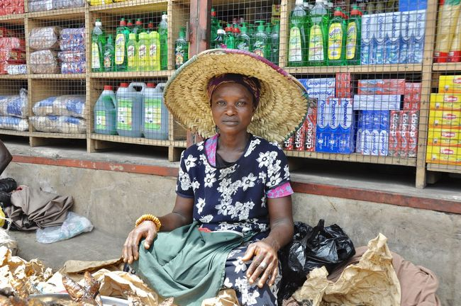 Accra Adult African African Beauty Culture Face Faces Of Africa Faces Of The World Ghana Horizontal Market Marketplace One Person Outdoors Selling Selling On The Street Straw Hat Tradition Woman Woman Portrait
