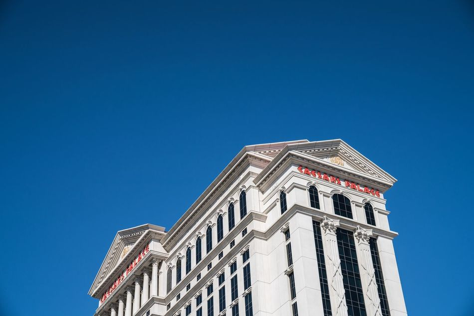 Hail! Building Exterior Architecture Blue Copy Space Clear Sky Built Structure Low Angle View Day USA USAtrip Roadtrip Lookingup Las Vegas Nevada Caesar Caesarspalace Hotel Negative Space Architecture Architecture_collection White Blue Sky Architecturelovers
