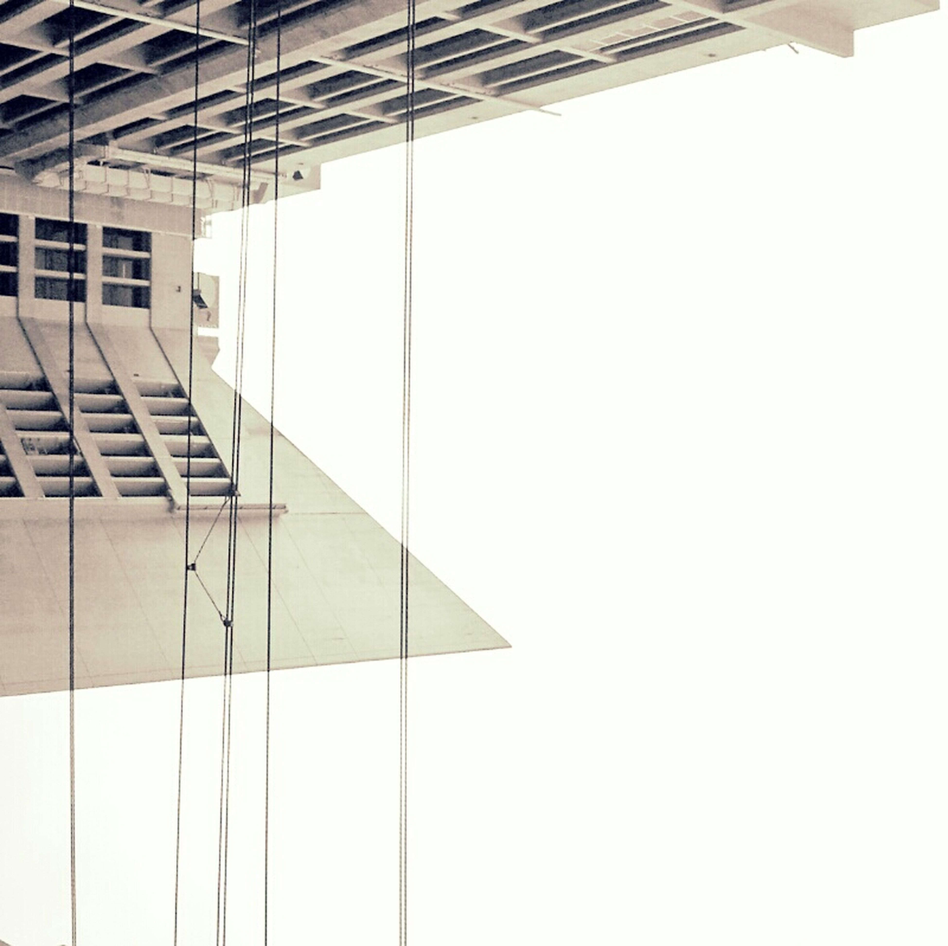 architecture, built structure, building exterior, modern, building, low angle view, indoors, clear sky, directly below, copy space, office building, city, ceiling, no people, window, day, geometric shape, sunlight, pattern, diminishing perspective