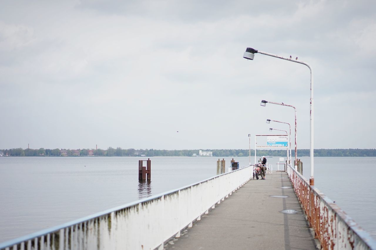 Long Jetty Leading To Calm Sea
