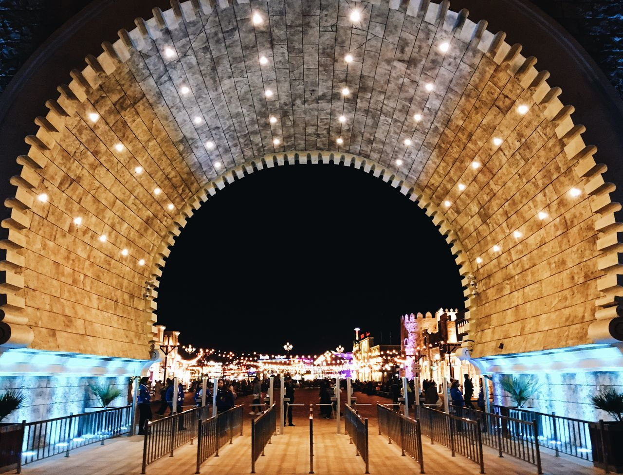 illuminated, arch, real people, large group of people, night, architecture, built structure, indoors, water, people
