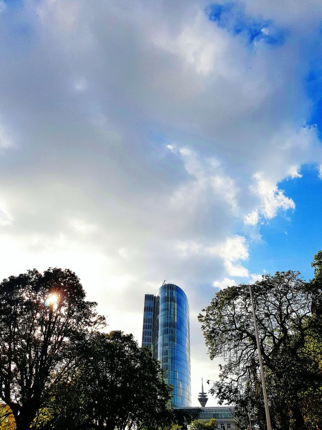 Architecture Architecture_collection White Sky Clouds Tower Sun Office Building Building Exterior Trees Autumn City Life Nature City Street TV Tower City Nature GalaxyS7Edge Blue Sky And White Clouds Rainy Day