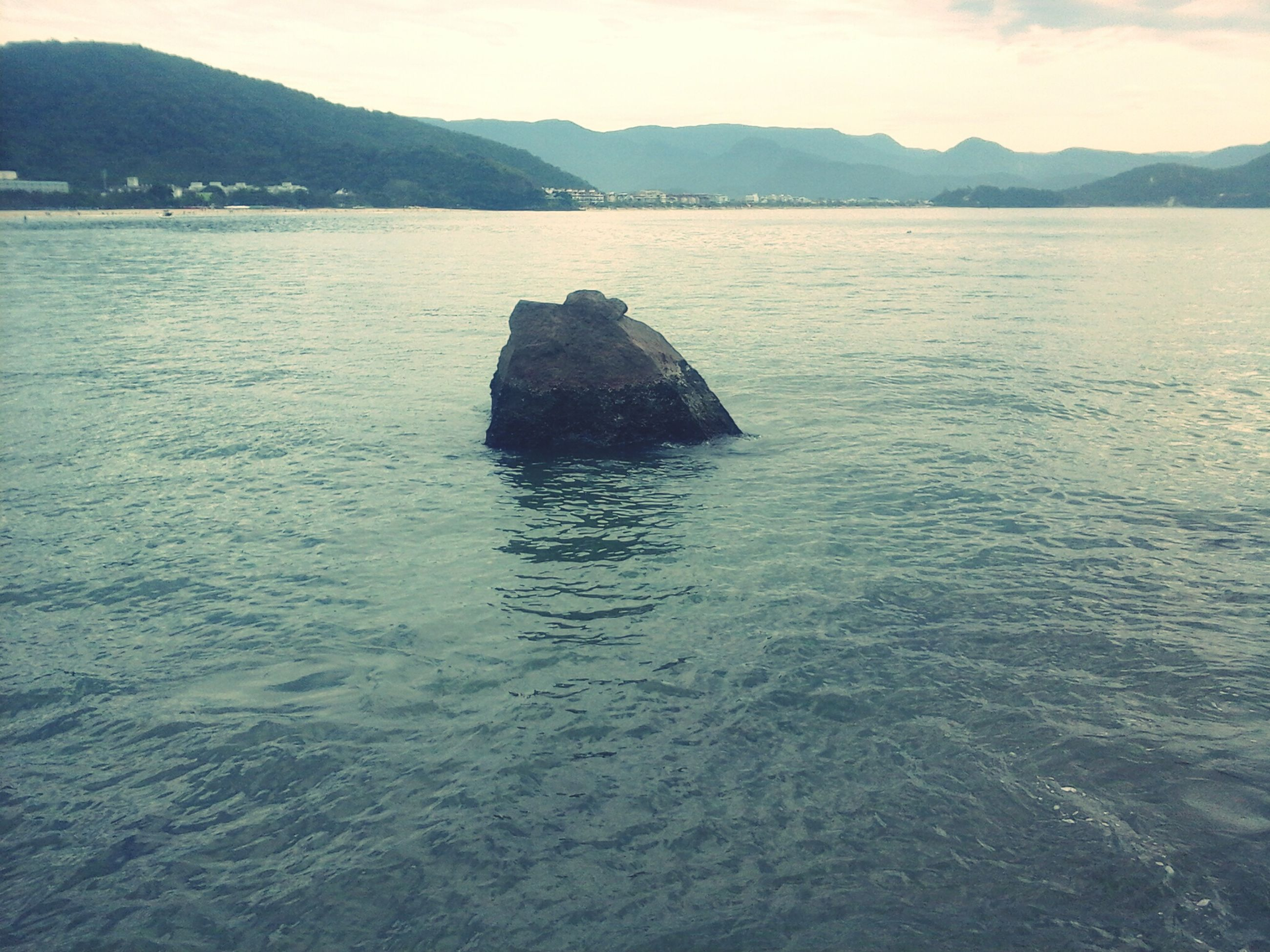 water, mountain, tranquil scene, tranquility, scenics, beauty in nature, mountain range, sea, lake, nature, waterfront, idyllic, sky, rippled, reflection, non-urban scene, calm, outdoors, remote, no people