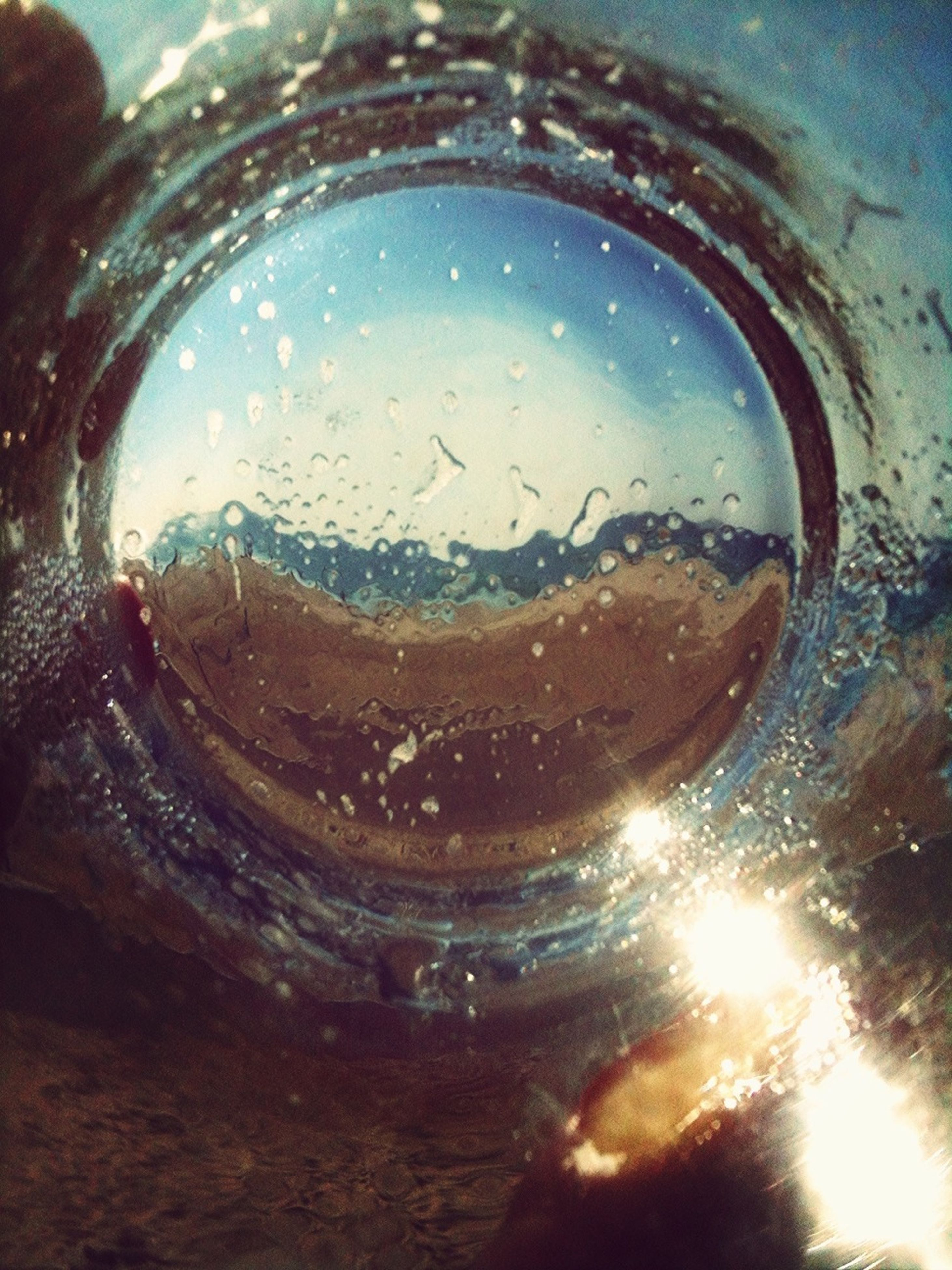 water, indoors, refreshment, close-up, transparent, drop, drink, glass - material, bubble, reflection, freshness, wet, full frame, drinking glass, glass, circle, backgrounds, purity, no people, liquid
