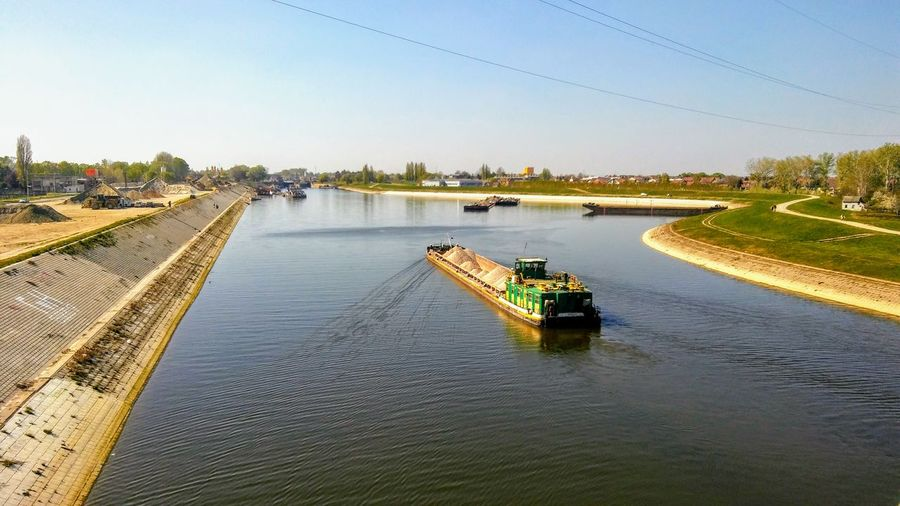 River transport Serbia Boats And Water Transport Boats River Channel Boats River Transportation River Transport Sailboat Riverside Photography Outdoor Photography Blue Sky And River Nautical Vessel Water Outdoors Transportation Day No People Clear Sky