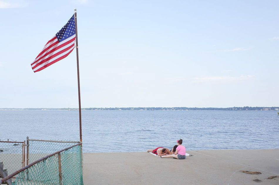 The world seen from behind Backhead Beach Behind Cloud Concrete Escapism Horizon Horizon Over Water New York City Outdoors Rear View Scenics Sea Sky The World Seen From Behind US Flag Water