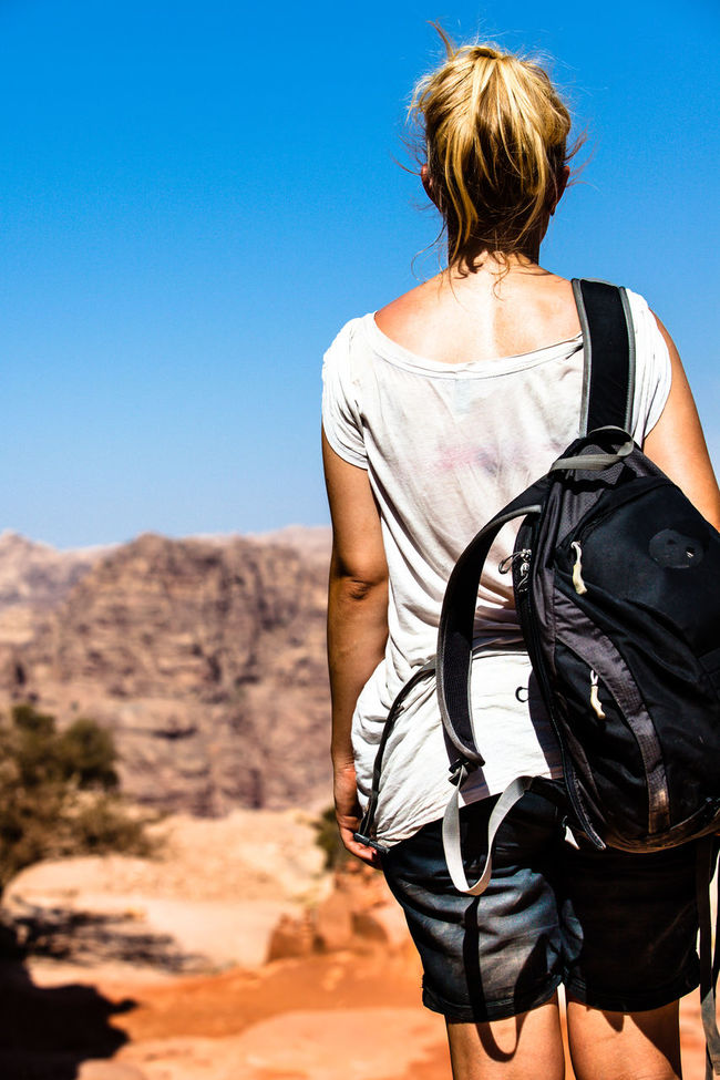 On the Top / shot in Petra / Jordan Back Beauty In Nature Blue Casual Clothing Clear Sky Colour Of Life Day Desert Hiking Idyllic Leisure Activity Lifestyles Mountain Nature Outdoors Pivotal Ideas Scenics Showcase August Sky Sunlight Sunny Sweat Tranquil Scene Tranquility Unrecognizable Person