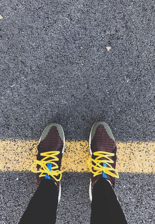Shoe Low Section Person Standing Personal Perspective Road Marking Road Street Yellow Directly Above Transportation Leisure Activity Footwear Casual Clothing Day Human Foot Limb