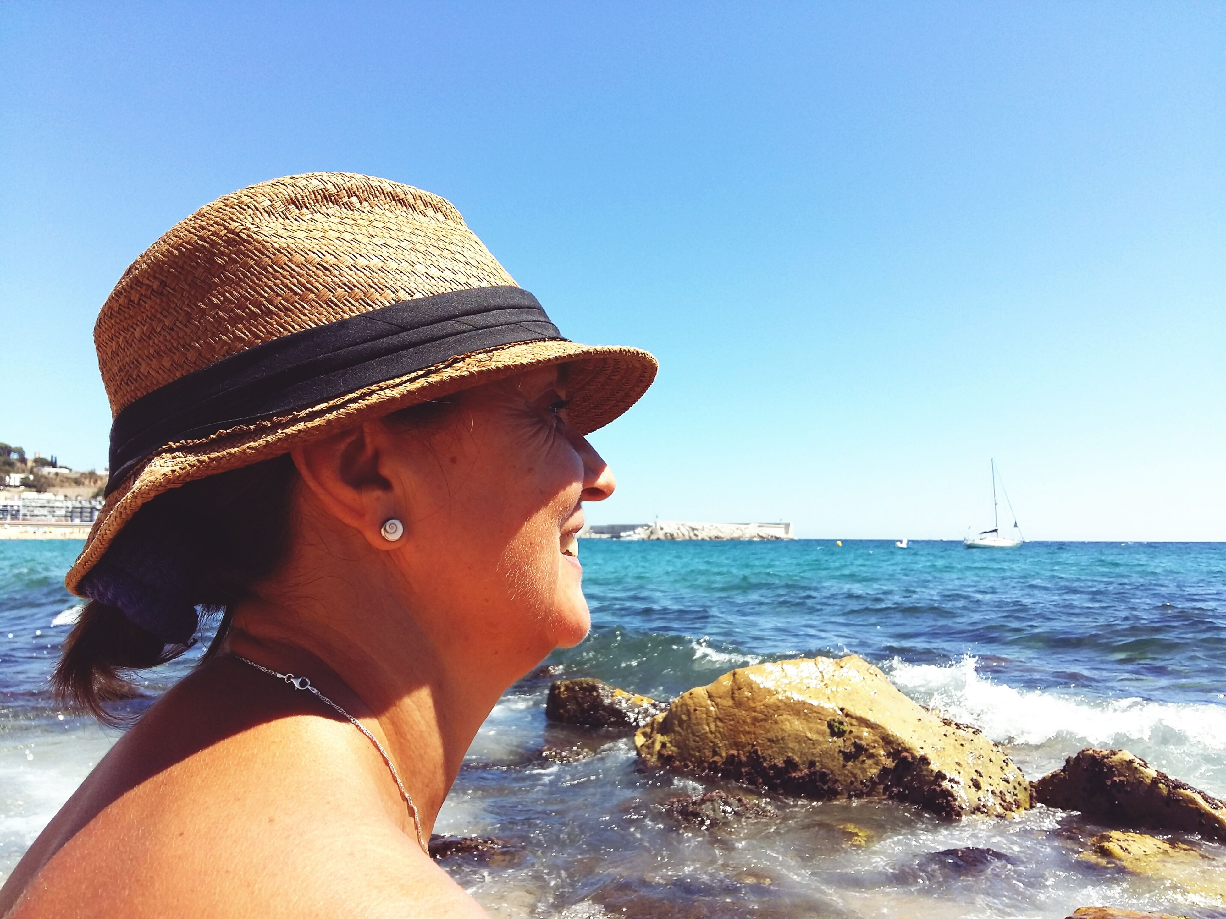 sea, clear sky, hat, water, lifestyles, horizon over water, headshot, sunlight, leisure activity, scenics, vacations, sunglasses, sunny, getting away from it all, beauty in nature, tranquil scene, knit hat, one mid adult man only, nature, tranquility, long hair, wave, young adult, day, blue, outdoors, in front of
