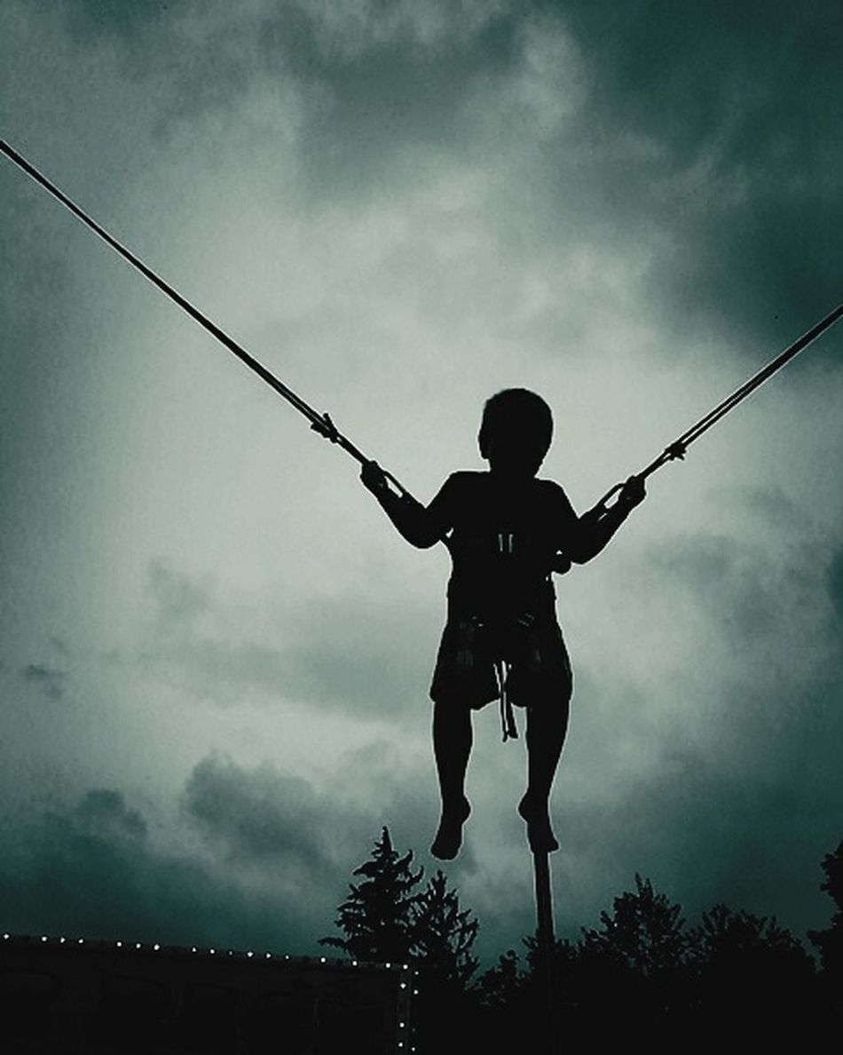 Trampoline Harness Jump Childhood Point Of View Point Silhouette Sil Low Angle View Sky Cloud - Sky Leisure Activity Childhood Silhouette Full Length Lifestyles Arms Outstretched Cable Casual Clothing Cloudy Scenics Nature Day Tall - High Carefree
