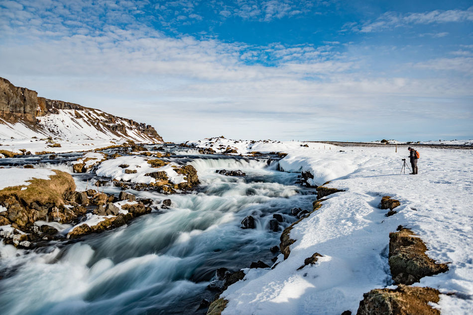 """And the water flows... The seemingly timeless landscape of Iceland is constantly changing. With all the volcanic activity, the island is both young and old. A bit like us. The water flows... (Nikon D810 24-70mm f/2.8 ƒ/3.2 24mm 0.5"""" 100) Adult Blue Cold Cold Temperature Copy Space Hiking Ice Iceland Landscape Long Exposure Nature One Person Outdoors People Photographer Scandinavia Scenics Snow Tourism Travel Destinations Vacations Water Winter"""