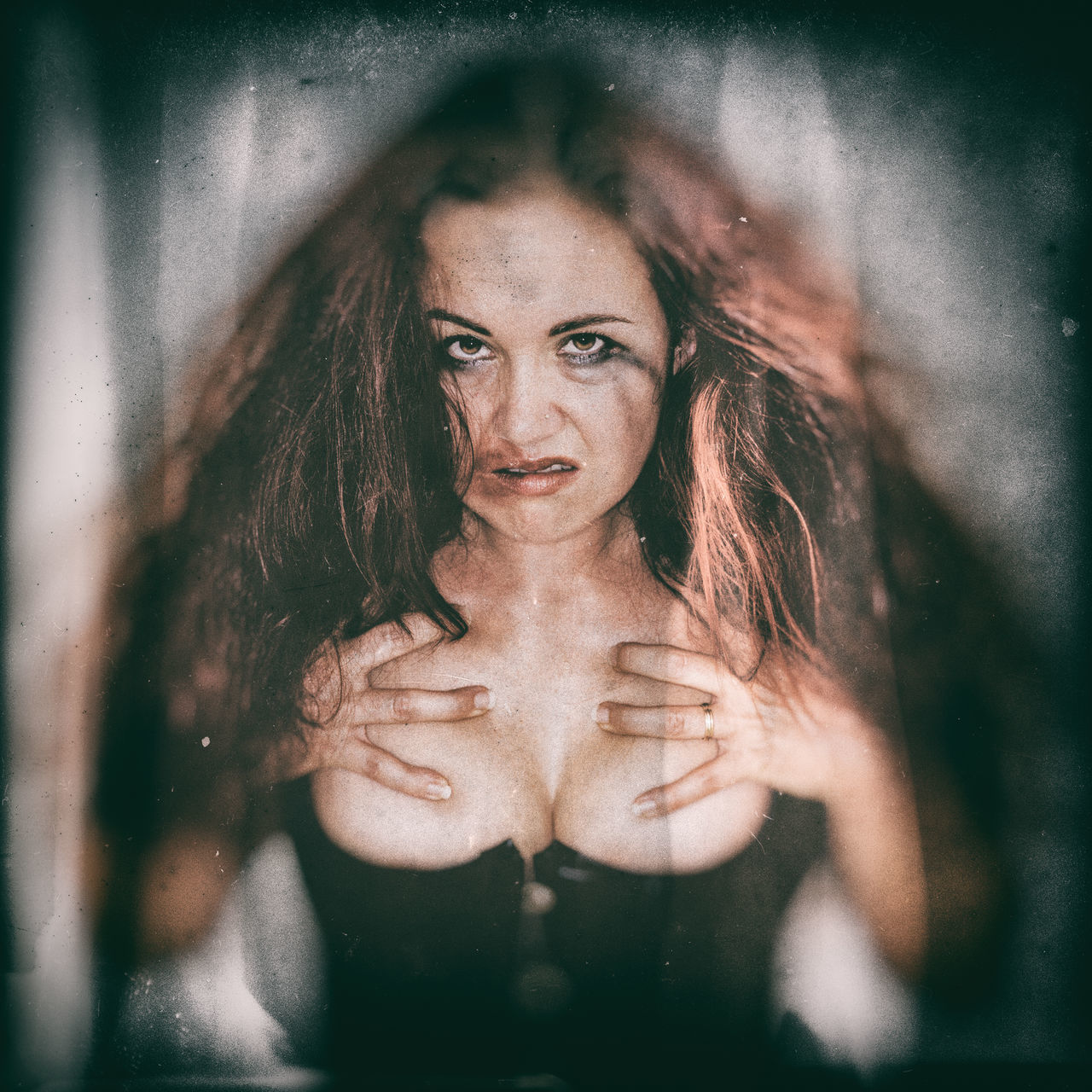 Portrait Of Spooky Woman With Hands On Chest Against White Background