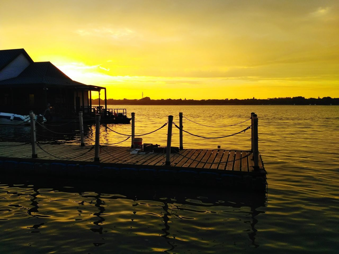 sunset, water, nature, beauty in nature, tranquility, scenics, sky, built structure, outdoors, silhouette, tranquil scene, sea, no people, architecture, day