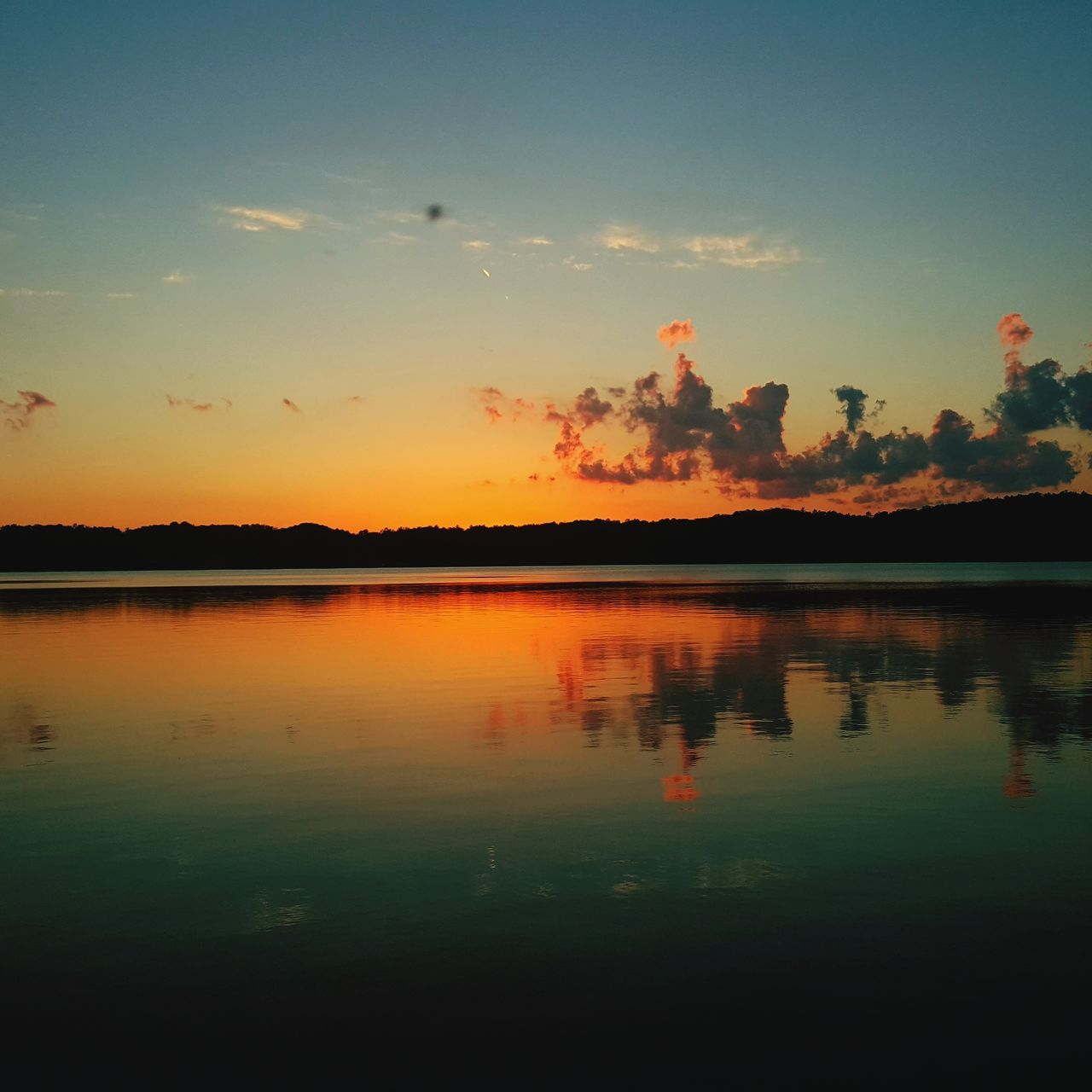 reflection, sunset, nature, sky, scenics, tranquility, beauty in nature, tranquil scene, water, silhouette, no people, lake, outdoors
