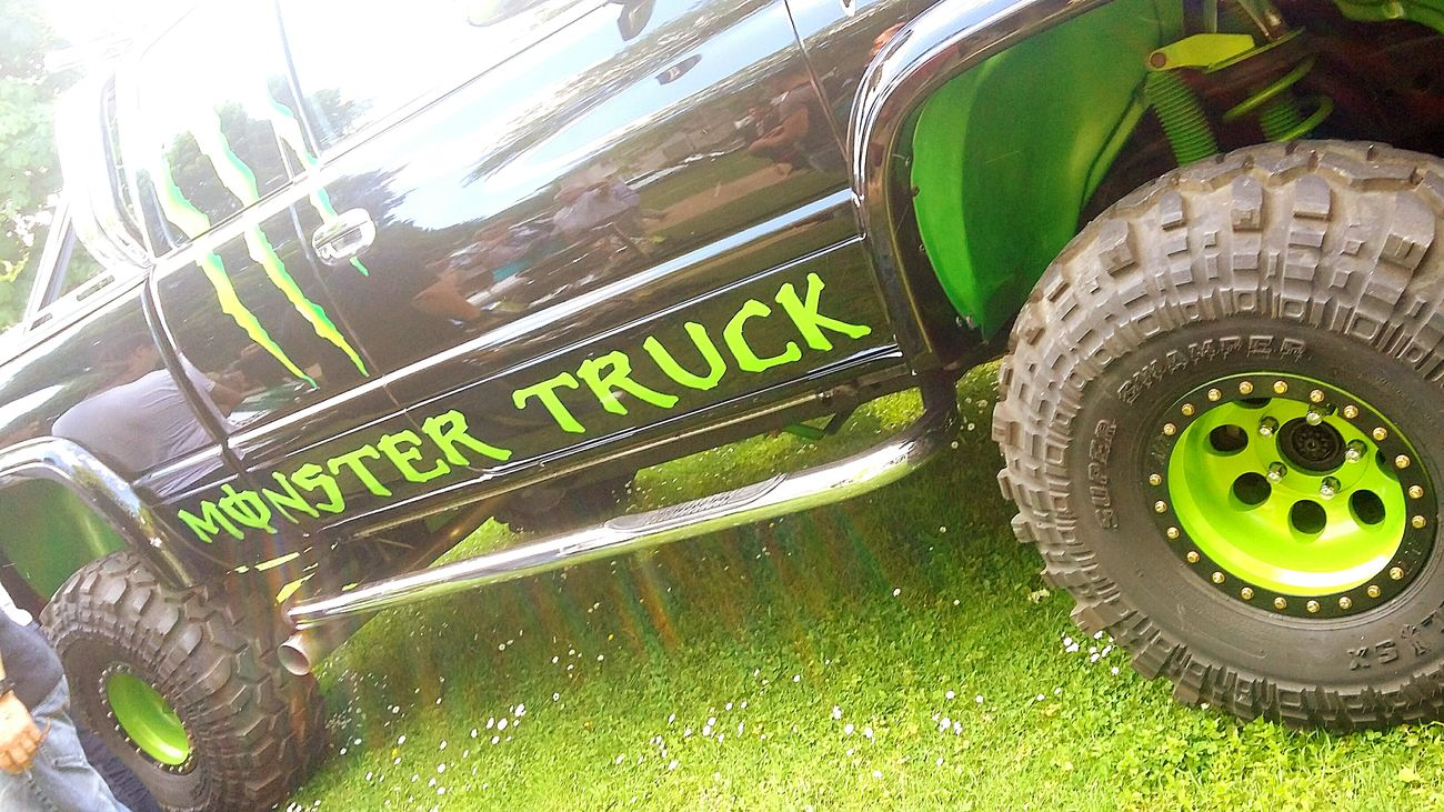 Text Communication Green Color No People Day Outdoors Grass Close-up Pickup Monster Nature Automobile Industry Voiture Collector's Car Mennecy