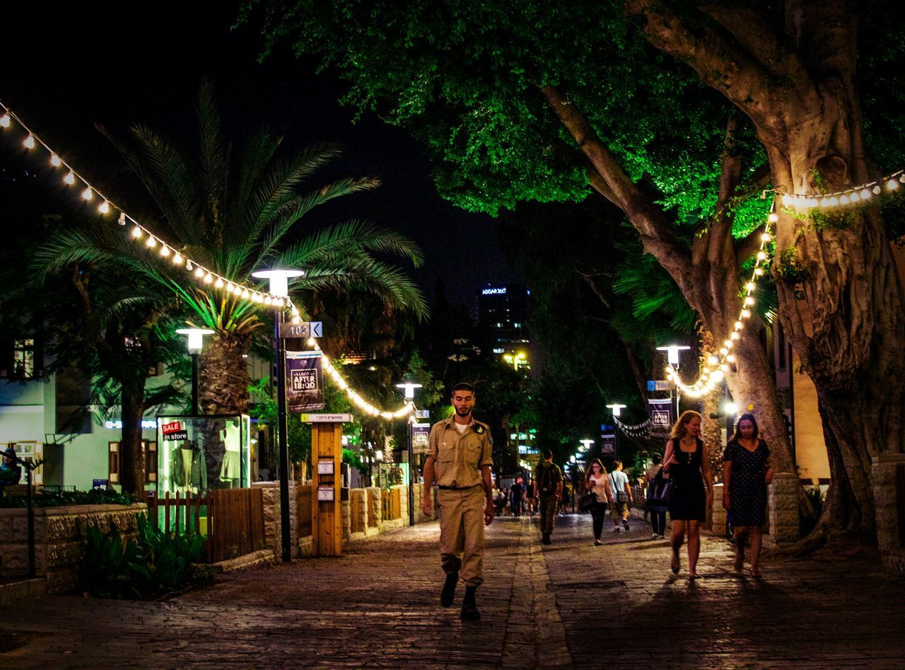 Night Illuminated Street Street Light City Life Person Israel Tel Aviv Soldier Lonley Photography Photooftheday Streerphotography City Light The Way Forward Fresh On The EyeEm People And Places New Photographer