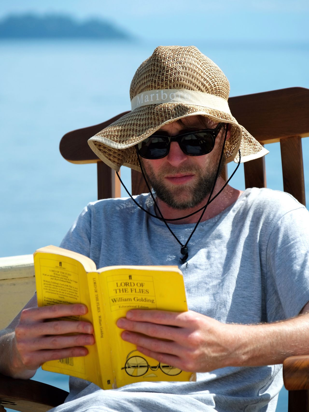 One Person Real People Hat Waist Up Front View Sunlight Lifestyles Beard Day Communication Leisure Activity Outdoors Sky Young Adult Book Reading Reading A Book Relaxing Portrait Holiday Man Travel Popular Photos in Mergui Archipelago , Myanmar