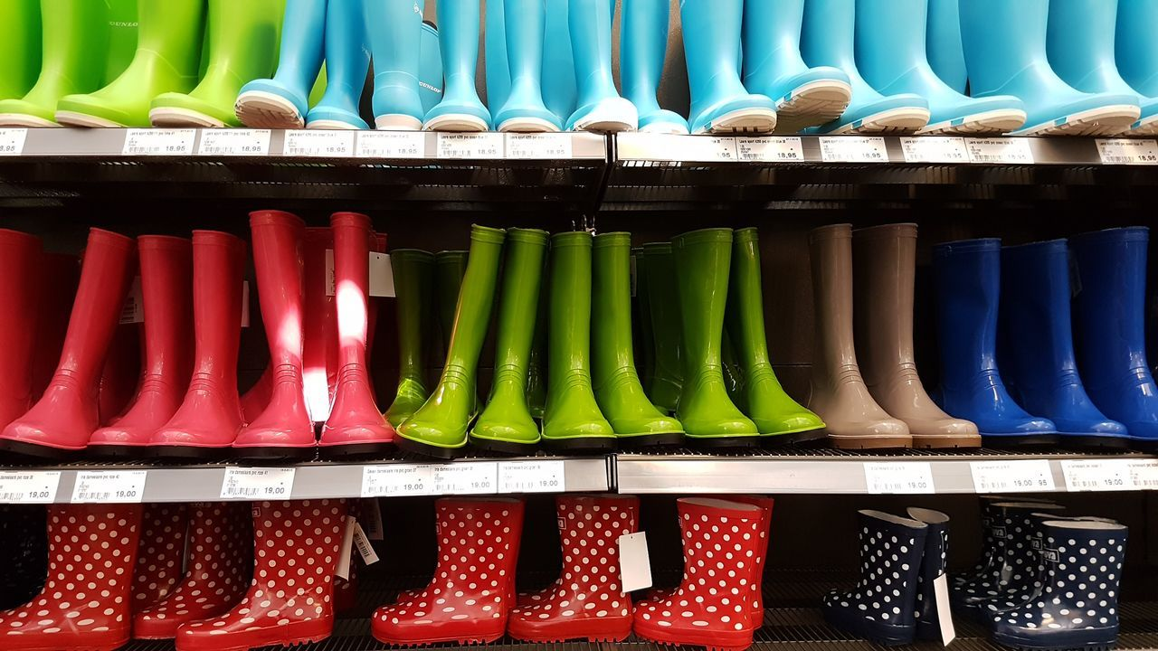Arrangement Autumn Bad Weather Shoes Boots Choice Colourful Fall In A Row Indoors  Large Group Of Objects Multi Colored Neat No People Rain Retail  Shelf Store