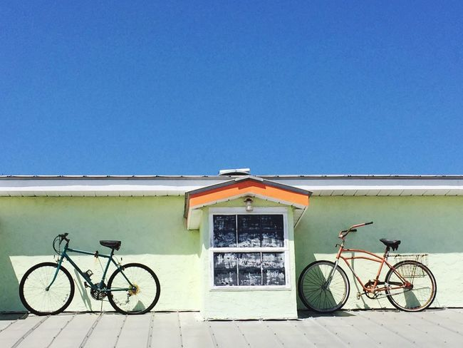 Bicycle Clear Sky Transportation Mode Of Transport Blue Building Exterior Outdoors Architecture Architectural Feature Rooftop Bike CyclingUnites Sunlight Day Sky No People Built Structure EyeEm Best Shots Architectural Detail