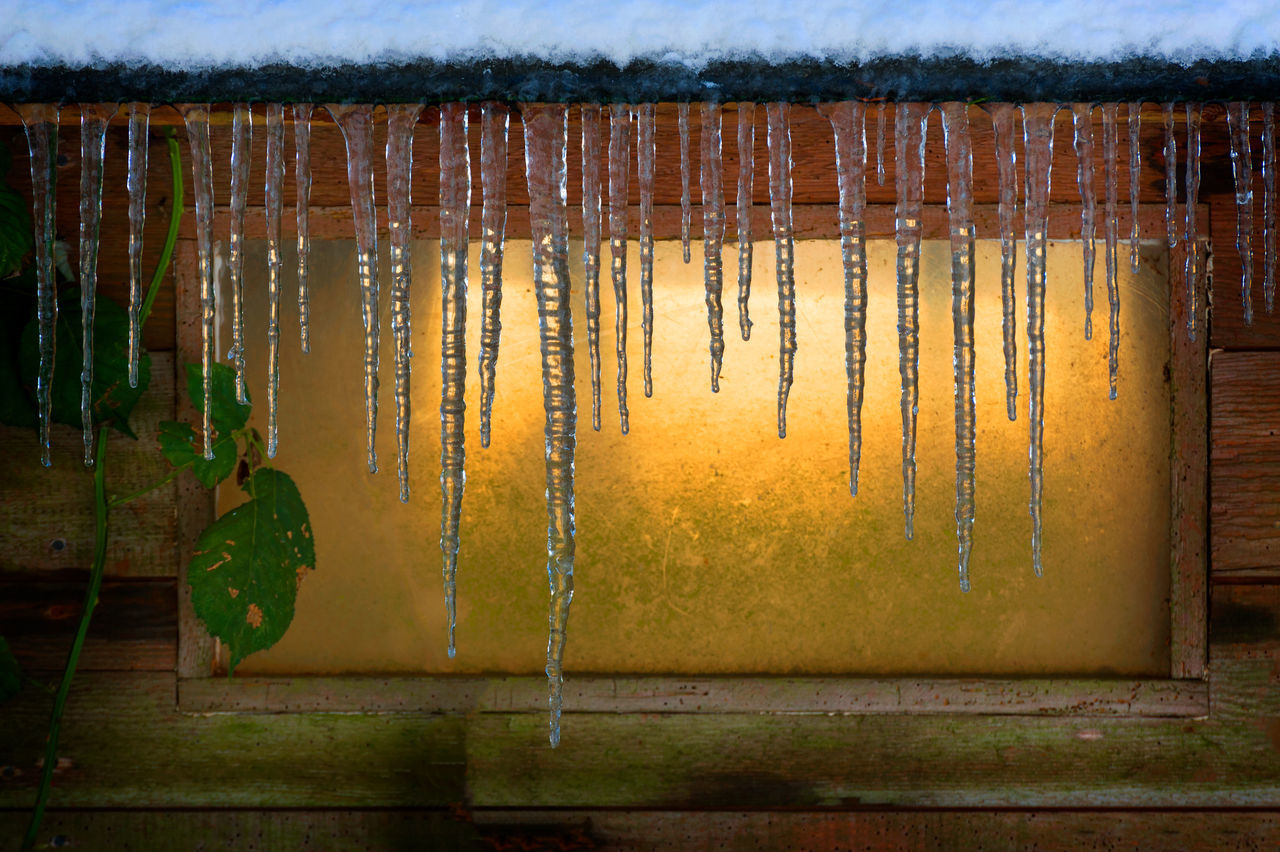 Winters Last Gasp. Icicles drape the roof line during winters frozen grasp. Backgrounds Close-up Cold Cold Temperature Colorful Drop Freeze Freezing Frozen Hanging Icicles Icicles Dripping Icicles Hanging Lummi Island Nature No People Outdoors Pacific Northwest  Puget Sound Season  Seasonal Sunlight Washington Water Winter