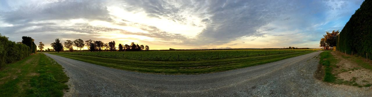 sky, road, the way forward, cloud - sky, nature, tranquil scene, beauty in nature, landscape, scenics, outdoors, tranquility, tree, panoramic, growth, grass, day, no people, rural scene, sunset, architecture