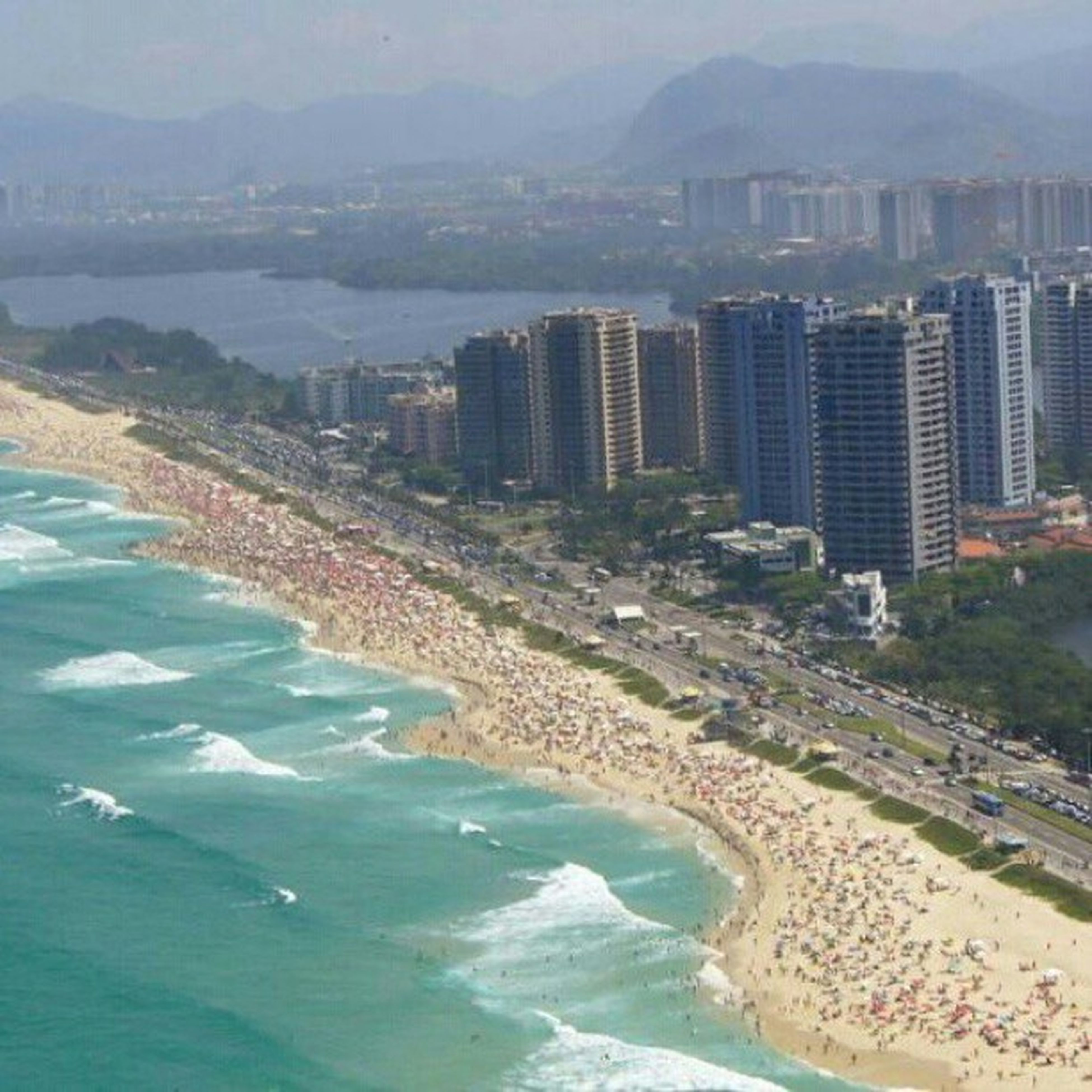 water, sea, beach, coastline, built structure, architecture, mountain, scenics, high angle view, shore, building exterior, sand, tranquil scene, tranquility, nature, beauty in nature, cityscape, city, aerial view, surf