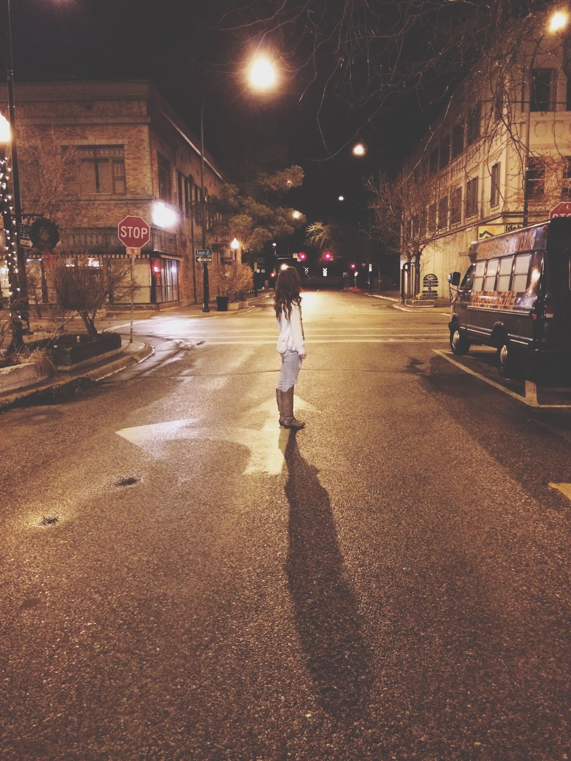 night, illuminated, street, full length, building exterior, lifestyles, walking, city, built structure, architecture, leisure activity, street light, men, city life, rear view, transportation, road, land vehicle
