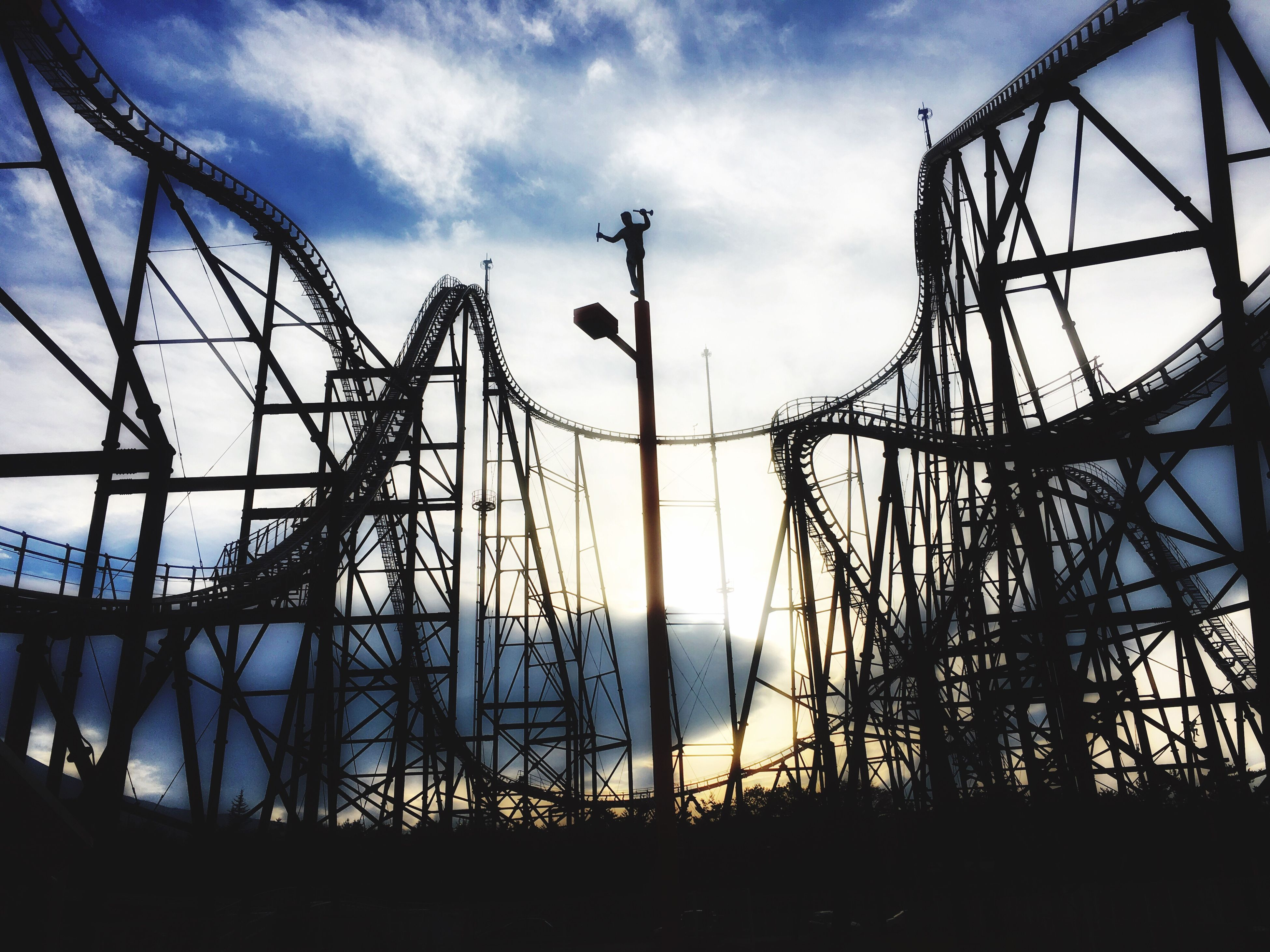 sky, metal, cloud - sky, amusement park, sunset, low angle view, no people, rollercoaster, silhouette, outdoors, tree, nature, day