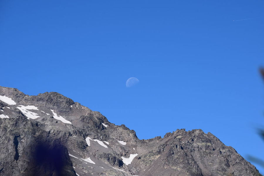 Moon over the mountain Astronomy Beauty In Nature Blue Clear Sky Day Landscape Moon Mountain Nature No People Outdoors Scenics Sky Tranquil Scene Tranquility Lost In The Landscape