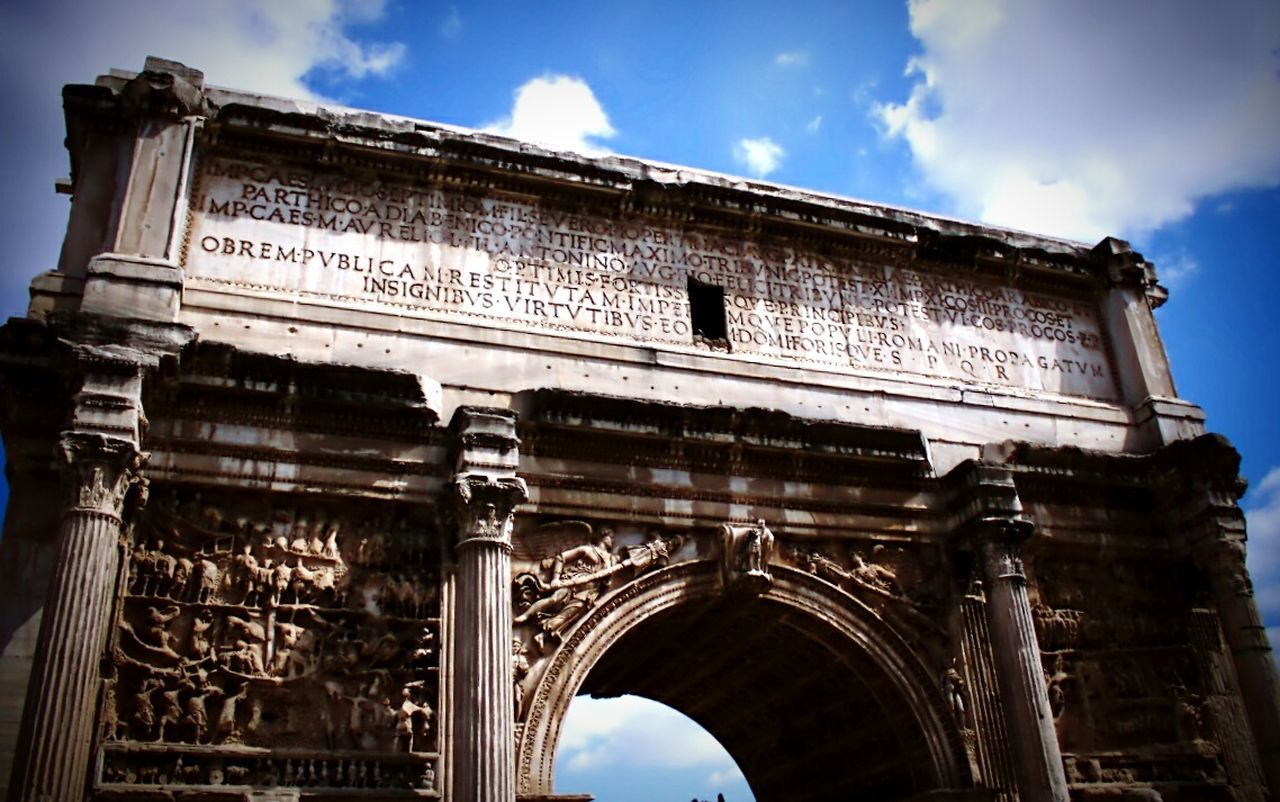 low angle view, architecture, history, sky, built structure, outdoors, tourism, triumphal arch, old ruin, ancient, no people, cloud - sky, travel destinations, day, ancient civilization