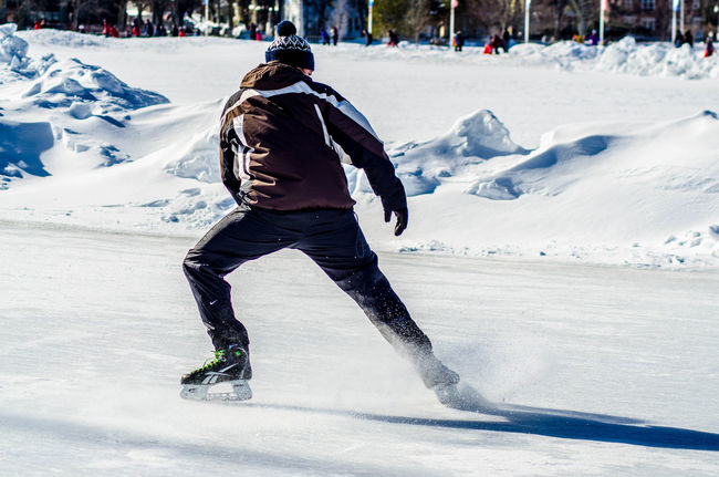 Adventure Casual Clothing Cold Temperature Day Enjoyment Extreme Sports Full Length Incidental People Leisure Activity Lifestyles Nature Rear View Season  Snow Sport Tourism Tourist Tranquil Scene Tranquility Vacations Walking Warm Clothing Weather Weekend Activities Winter