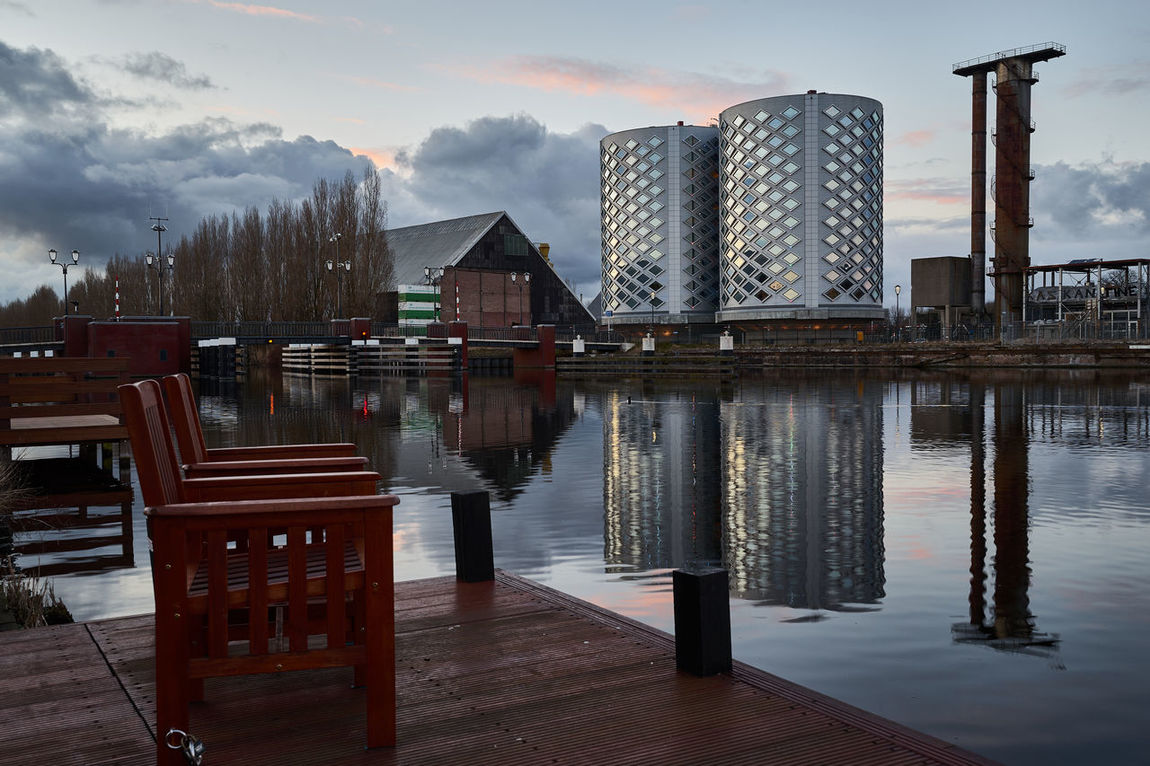Waterside views Architecture Calm Canal Chair Dusk Dutch Enjoying The View Europe Halfweg Holland Holland❤ Nederland Netherlands Peace Peace And Quiet Peaceful Q Quiet Quiet Moments Reflection Silo Water Water Reflections Waterfront
