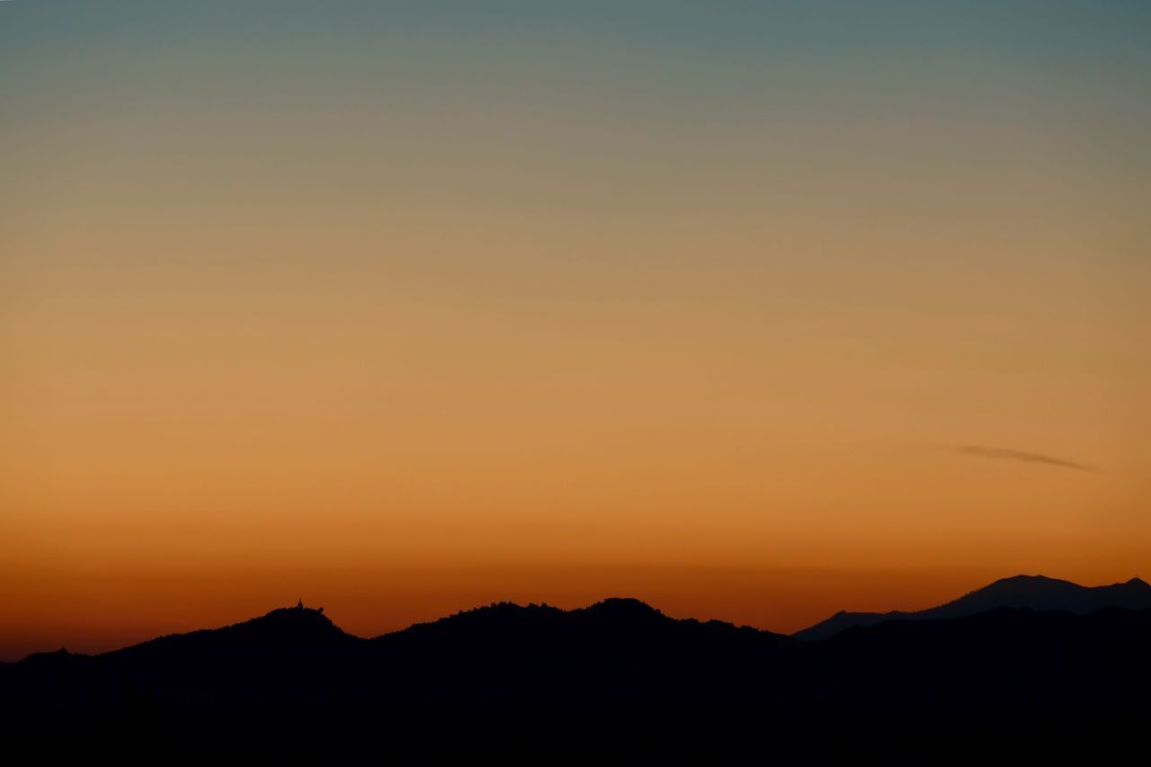 sunset, silhouette, nature, tranquil scene, scenics, tranquility, beauty in nature, orange color, mountain, outdoors, no people, sky, landscape
