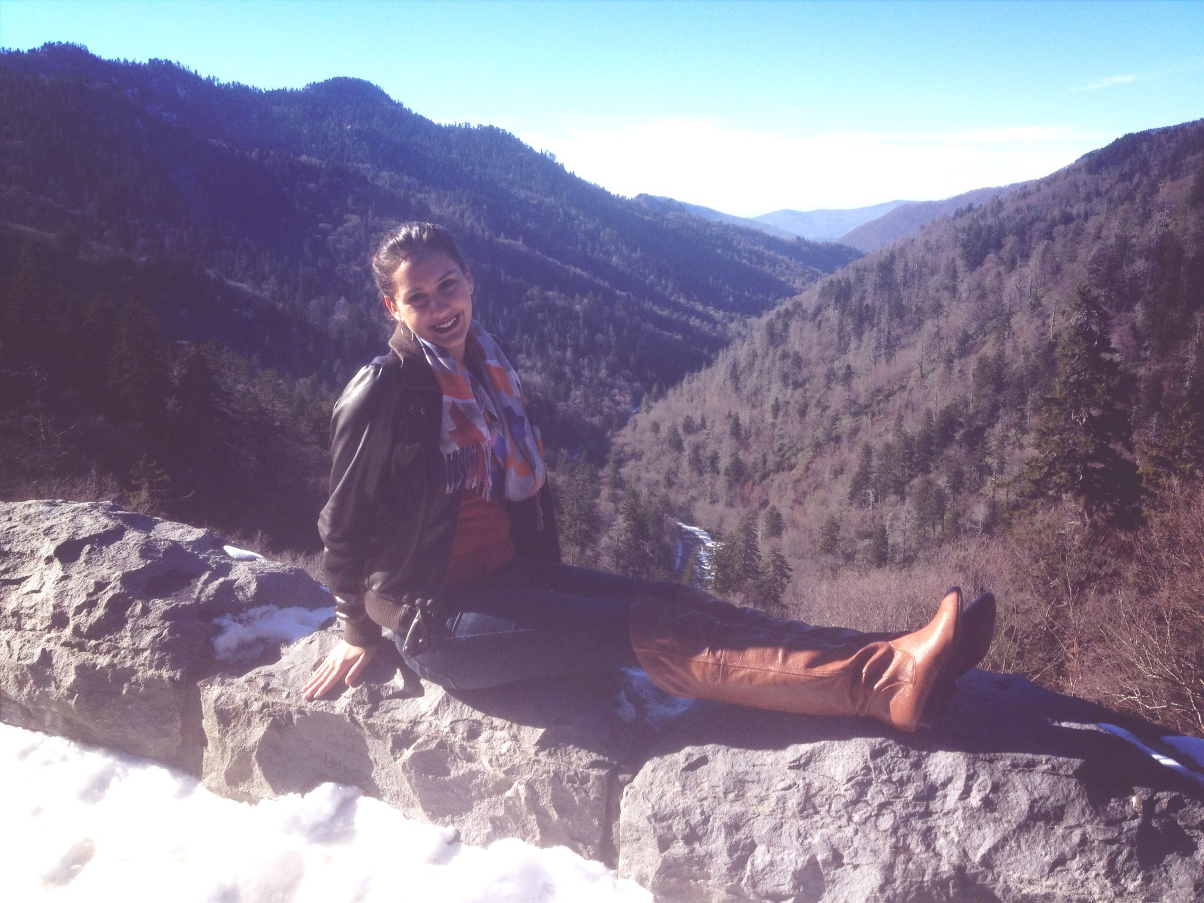 mountain, lifestyles, leisure activity, young adult, casual clothing, person, full length, mountain range, young men, rock - object, looking at camera, portrait, vacations, standing, nature, beauty in nature, landscape