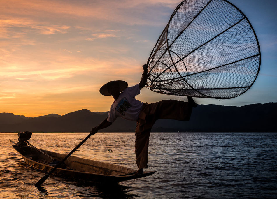 Adult Adults Only Fisherman Fishing Net Kayak Lake Nautical Vessel One Man Only One Person Only Men Outdoors People Place Of Worship Silhouette Sky Sport Sunset