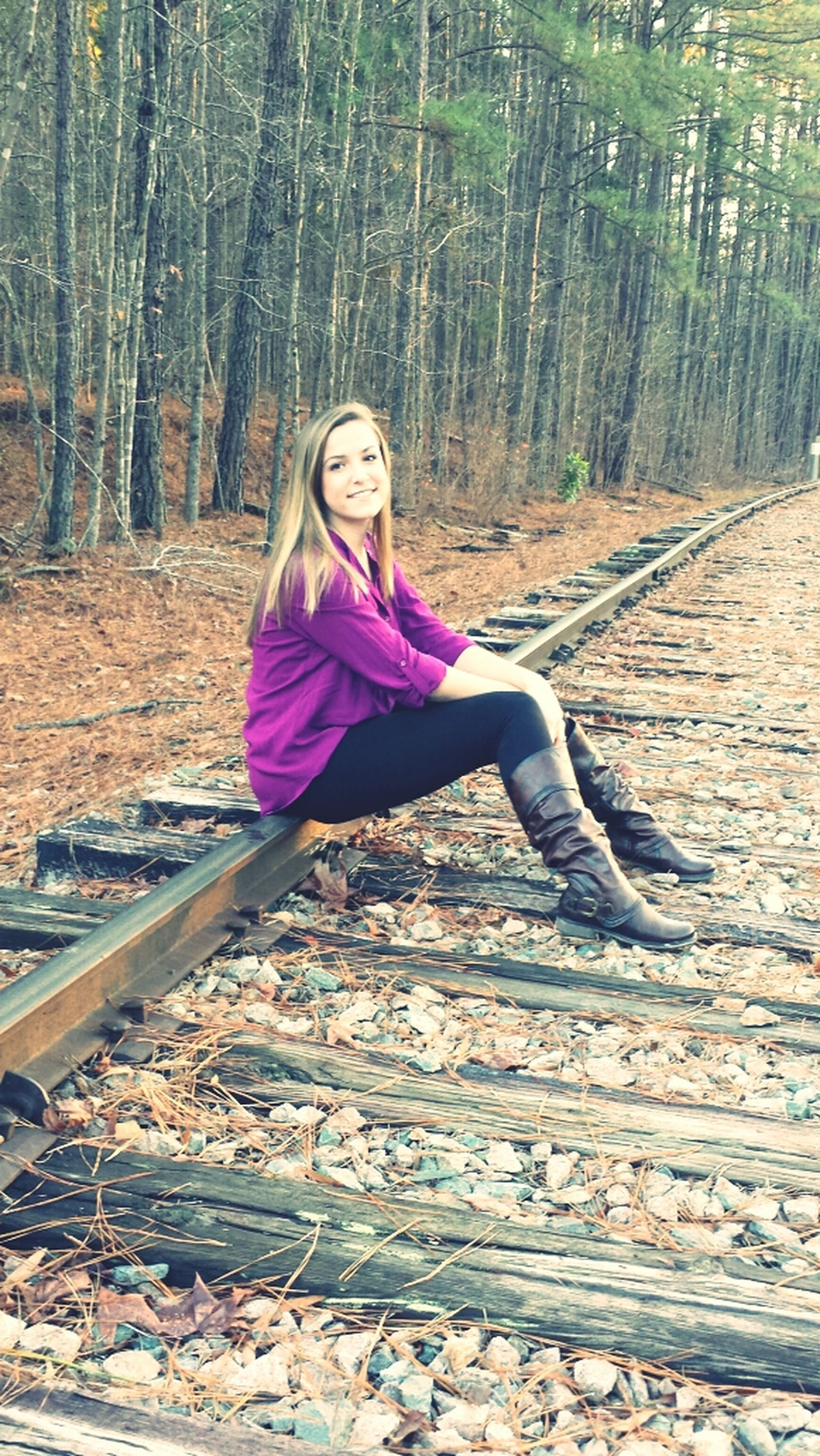 full length, person, casual clothing, lifestyles, young adult, leisure activity, tree, looking at camera, forest, portrait, front view, young women, standing, smiling, sitting, happiness, carefree, wood - material