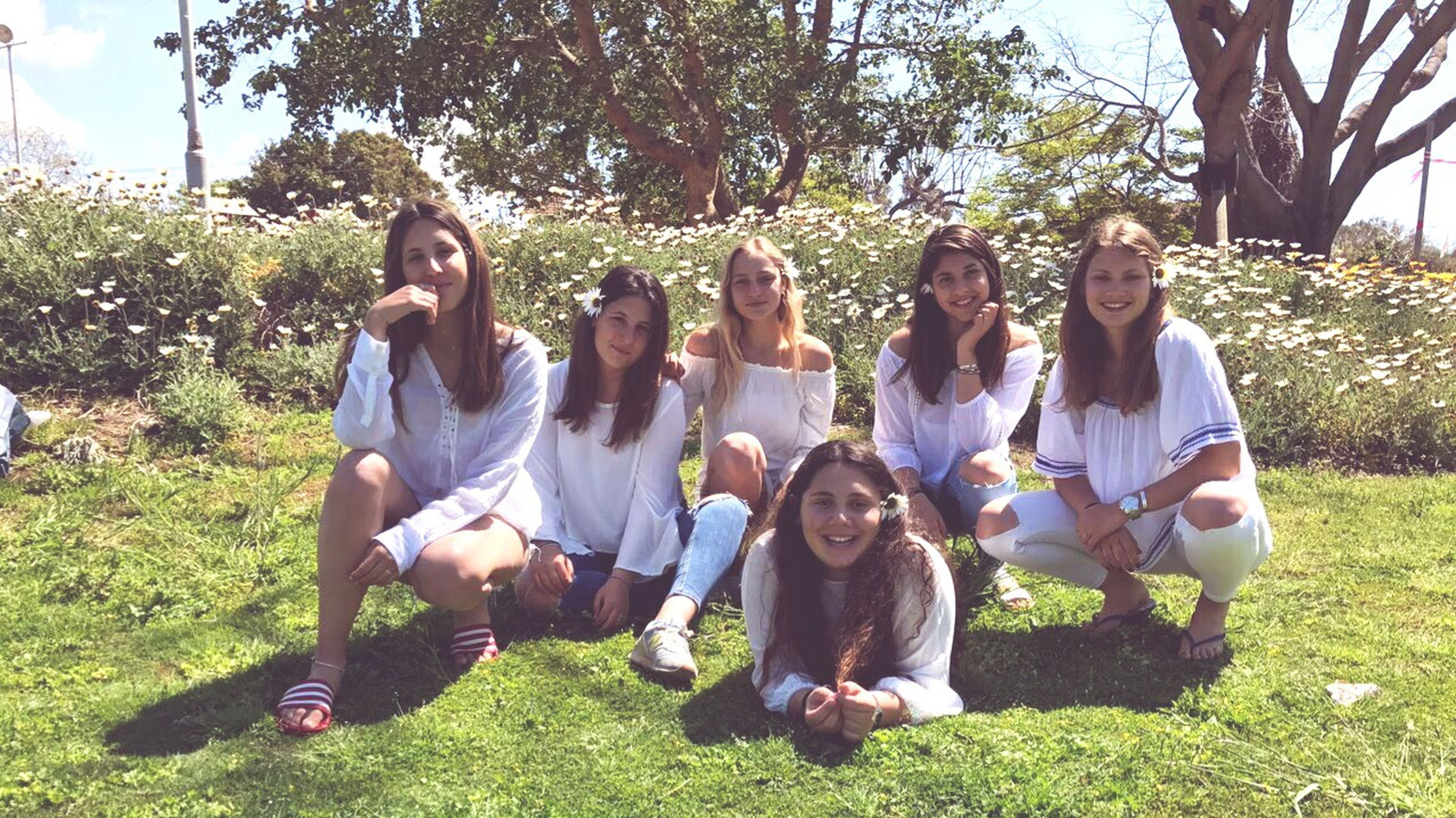 friendship, casual clothing, togetherness, relaxation, happiness, mature adult, fun, young adult, young women, sitting, tree, enjoyment, smiling, summer, looking at camera, portrait, full length, bonding, leisure activity, people, grass, lifestyles, guitar, adult, mature women, outdoors, plucking an instrument, pets, dog, real people, playing, cheerful, nature, day, adults only