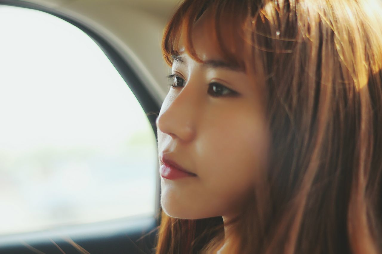 One Woman Only Only Women Adults Only One Person One Young Woman Only Headshot Young Adult Contemplation Young Women Adult Looking Away Transportation Beautiful Woman Portrait Women Close-up Window Beauty Car People