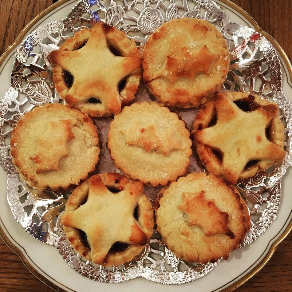 Plate of homemade Mince Pies from scratch Baking Chef Christmas Festive Food Flat Lay Fresh From Scratch Golden Holly Homemade Mince Pies Mincemeat On A Plate Pastry Patisserie Seven Star Tradition