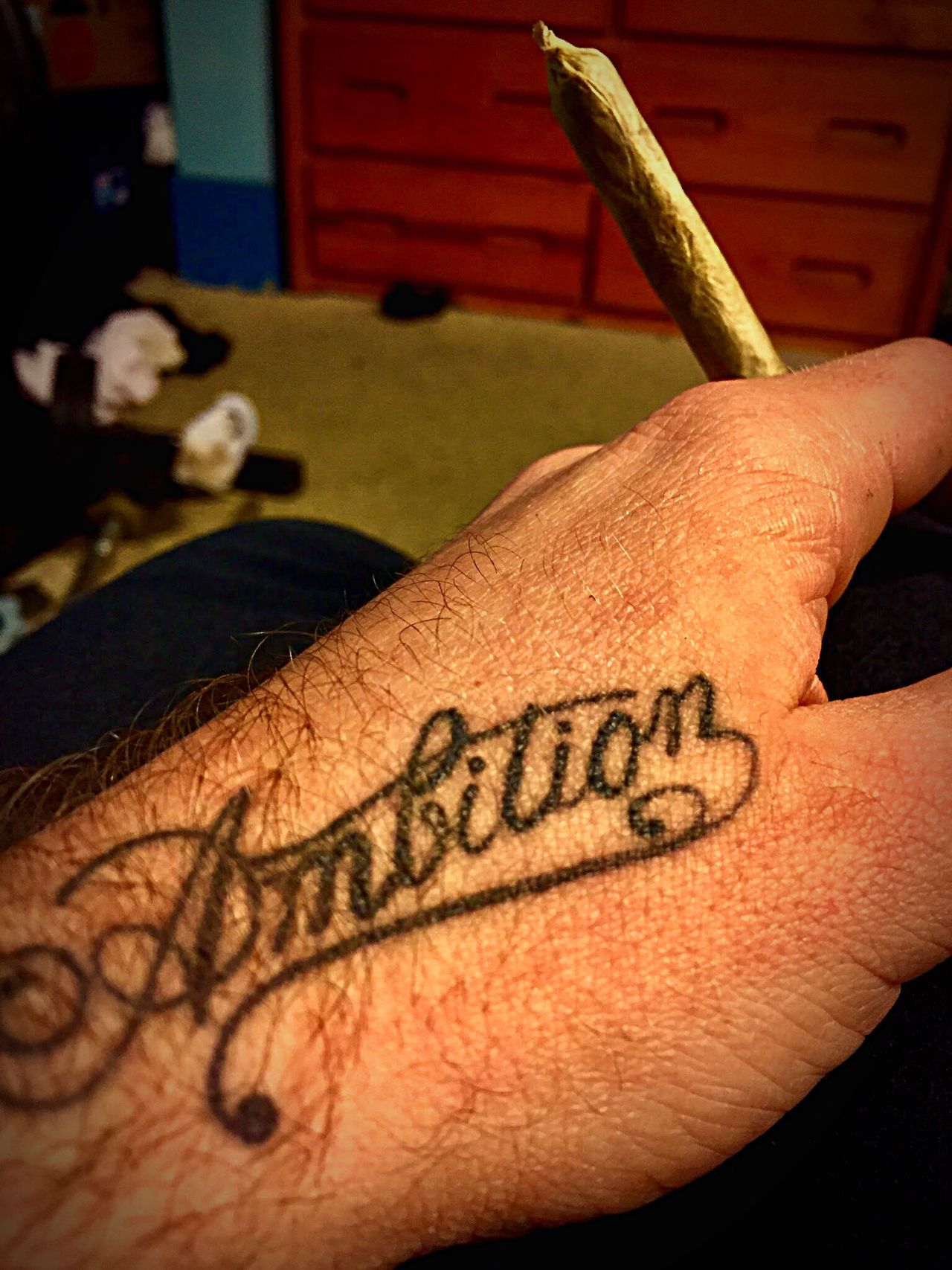 """Ambition is priceless and I put that on my name"" -Wale Ambition Joint Human Hand Human Body Part Real People Lifestyles Text Indoors  Close-up Holding Marijuana Greenisgood High_larry_us Yolo 530 Yolo County WoodLand California DontKillMyVibe Smoke Weed Cannabis Plant Wakeup"