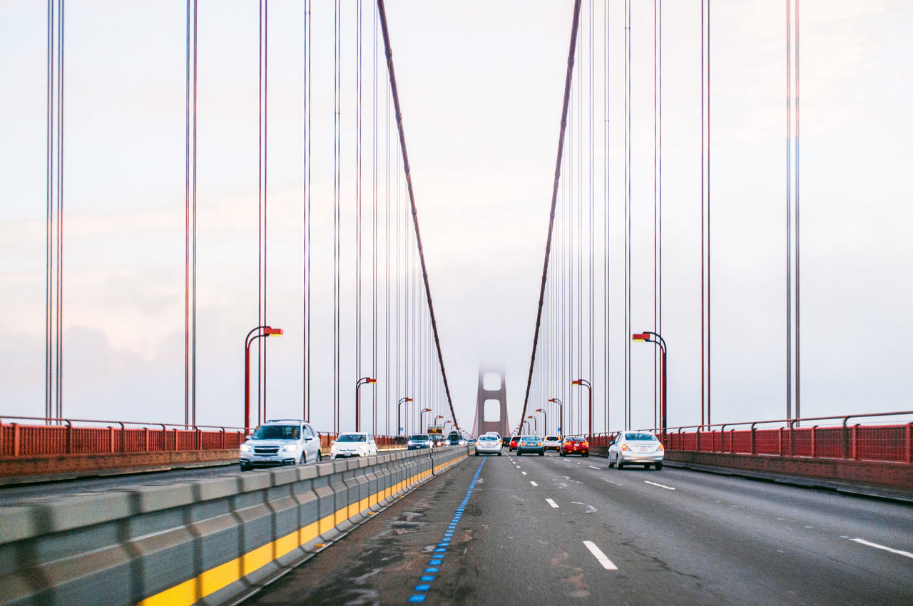 Architecture Bridge - Man Made Structure Building Exterior Built Structure Car City Cityscape Cloud - Sky Connection Day Distant Engineering Golden Gate Bridge Land Vehicle No People On The Move Outdoors Road Sky Steel Cable Suspension Bridge Traffic Transportation Urban Road