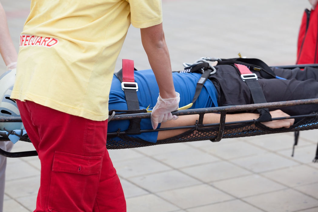First aid training. Paramedics providing first aid to an injured person Accident First Aid Training Health And Medicine Hospital Injured Person Medical Exam Men Outdoors Paremedics Patient People Real People Wound